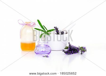 lavender flowers lavander extract oil and montar with dry flowers isolated on white.