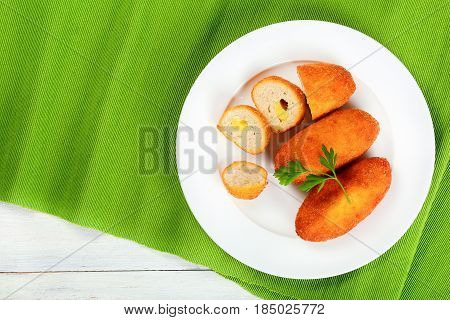 Deep Fried Chicken Rissoles On White Plate