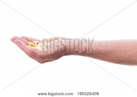 male hand is holding lot of pills isolated in front of white background