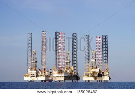 Labuan,Malaysia-May 1,2017:View of Jackup Rigs in Labuan island,Malaysia.Jackup rig is a floating barge fitted with long support legs that can be raised or lowered.