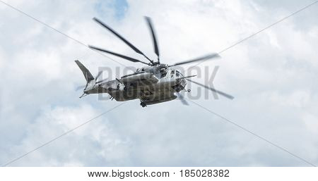 BEAUFORT, SOUTH CAROLINA-APRIL 20, 2017: A CH-53E Super Stallion helicopter flies and banks over the Marine Corp Air Station in Beaufort, South Carolina
