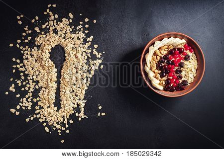 Oatmeal In Bowl With Berries, Bananas And Walnuts