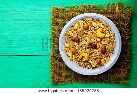 muesli with nuts(hazelnuts, cashews, almonds). muesli on a wooden table. muesli top view . healthy food .