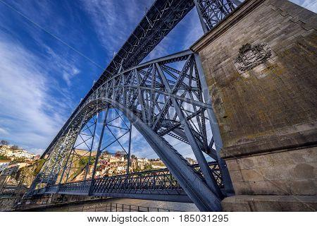 Dom Luis I arch bridge seen from Vila Nova de Gaia city with Porto city on background Portugal