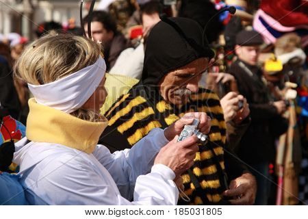 People In Bug Costumes Taking Photographs At The Venice Carnival In Italy