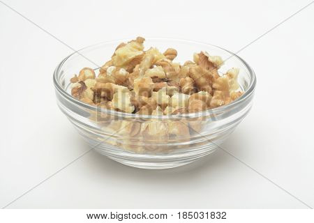 Nuts in a cristal bowl on white background