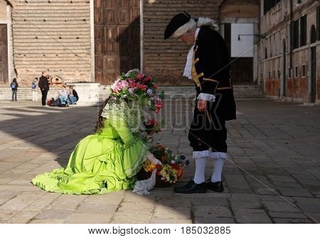 People In Costumes At The Venice Carnival In Venice, Italy