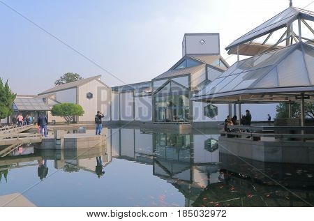 SUZHOU CHINA - NOVEMBER 3, 2016: Unidentified people visit Suzhou museum. Suzhou museum is a museum of ancient Chinese art, ancient Chinese paintings calligraphy and handmade crafts.