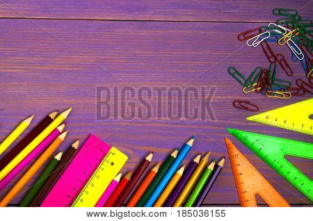 School supplies (pencil, pen, ruler, triangle) on blackboard background ready for your design .school supplies top view .