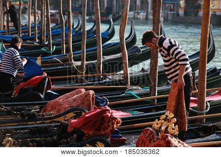 Gondoliers Preparing Their Gondolas On The Grand Canal In Venice, Italy