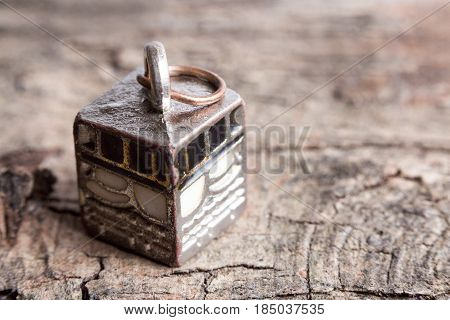 Miniature of Kaabah on a tree bark background