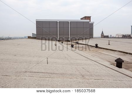 an flat roof with roofing and Safety line