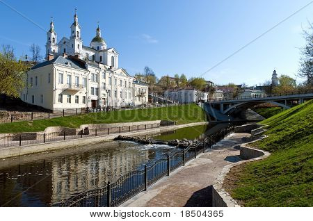 Belarus Nice Vitebsk Spring Landscape View Of St. Uspenski Cathedral Over Vitba River With Little Wa