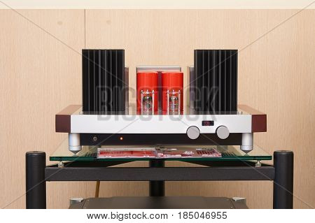 Tube amplifier on the table in the room