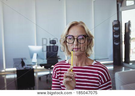 Thoughtful entrepreneur wearing eyeglasses at office