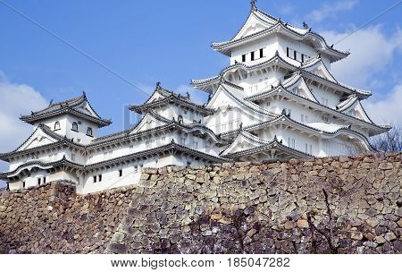 Amazing Japanese national architecture - Himeji castle or White Egret Castle, standing on large foundation from a stone. It is a popular sightseeing location in Japan, and is listed as an UNESCO world heritage.