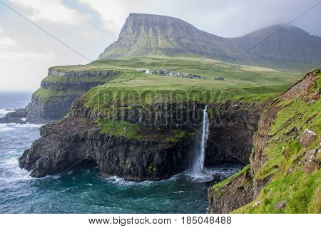 The Mulafossur waterfall in Gasadalur, Faroe Islands is one of the most remarkable sights to see.
