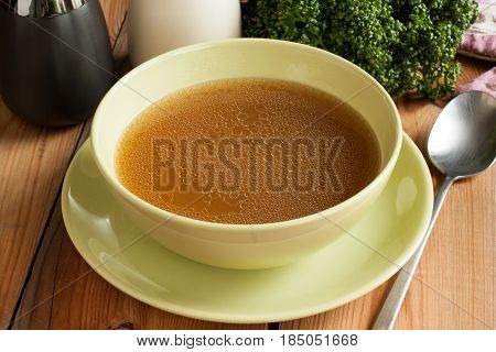 Bone Broth Made From Beef, Served In A Green Soup Bowll
