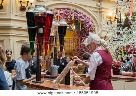 MOSCOW, RUSSIA - May 1, 2017. Pouring lemonade at the counter in GUM