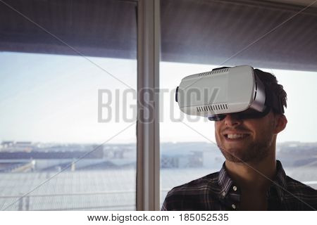 Close up of businessman wearing virtual reality headset in office