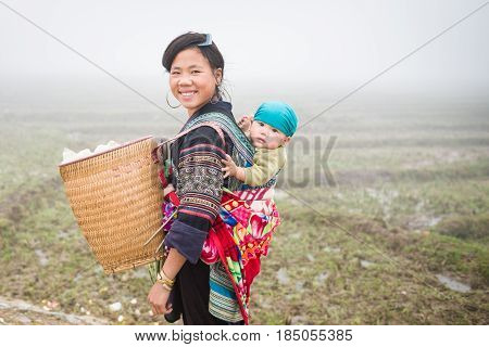 SAPA, VIETNAM - DEC 04: Unidentified H'mong woman in Sa Pa, Vietnam December 04, 2012. Sapa is a mountain town in Vietnam and H'mong are the 8th largest ethnic group in Vietnam.