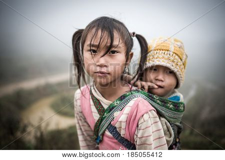 SAPA, VIETNAM - DEC 04: Unidentified H'mong's child in Sa Pa, Vietnam December 04, 2012. Sapa is a mountain town in Vietnam and H'mong are the 8th largest ethnic group in Vietnam.