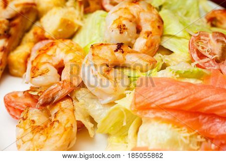 Background From Salad Of Romaine Lettuce With Prawns, Smocked Salmon, Croutons, Grilled Chicken, Che