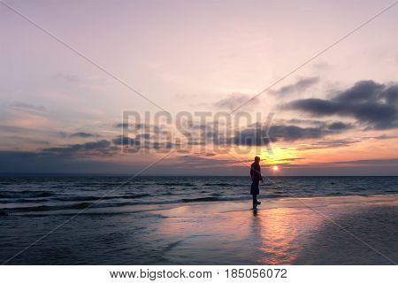silhouette at sunrise on the beach / the bright dawn of early spring Ukraine