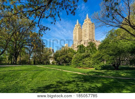 Central Park West Summer morning with Art Deco high-rise building. Upper West Side Manhattan New York City