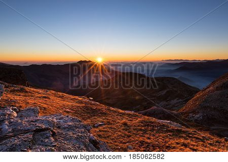 Mountain Range At Sunset, Backlight With Sunburst, Italian Alps