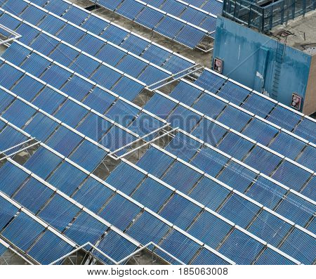 Water solar panels installed on flat roof