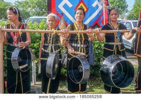 Penampang,Sabah-May 31,2016:Group of Kadazandusun woman,ready to perform playing gong during Sabah Harvest festival celebration in Kota Kinabalu,Sabah,Borneo, Malaysia.