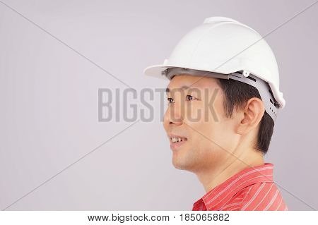Happy Engineer Wear Red Shirt And Hat Look To Side