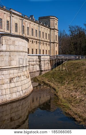 Gatchina Palace. Russia. The right wing of the palace. Water ditch and a bridge through it. Each corner of the palace has a watchtower.
