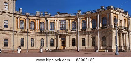 Gatchina Palace. Russia. The right wing, an old street lamp, guard booths and barriers. The second floor is decorated with graceful columns.