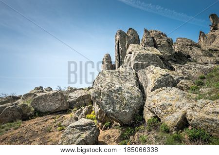 Rocks formations in Dobrogea, Tulcea county, Romania. Naturally formed piles of large rocks in Macin Mountain the olders alps in Europe
