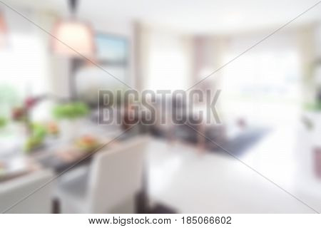 Blurred Living Room With Dining Table In Modern Interior