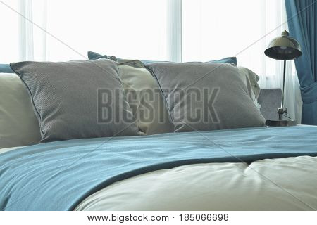 Gray Pillows On Bed With Bed Runner In Blue Color