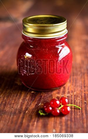 Fresh homemade red currant jam or sauce in a jar, selective focus