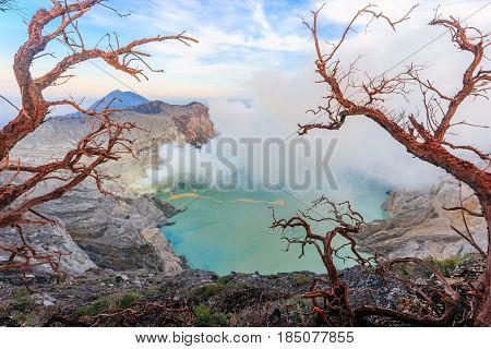 Panoramic view sunrise at Kawah Ijen volcano and sulphur lake near Bondowoso Baluran National Park - Jawa island Indonesia