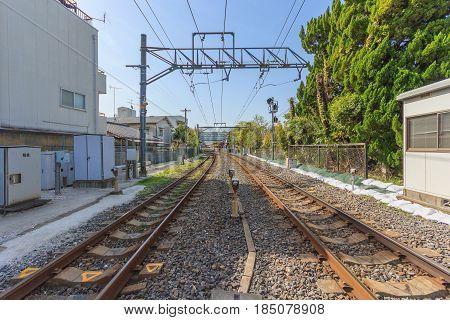 KYOTO, JAPAN -APRIL 15 2015: Local railroad and Railroad crossing in Kyoto Japan.