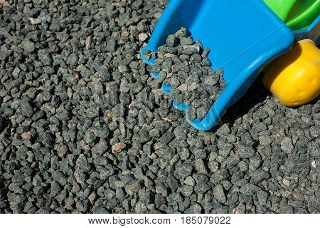 Coarse gravel - stone texture. Bucket of excavator collects crushed stone