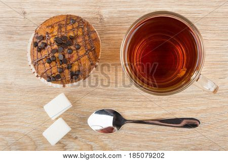 Muffin With Chocolate, Cup Of Tea, Lumpy Sugar And Spoon