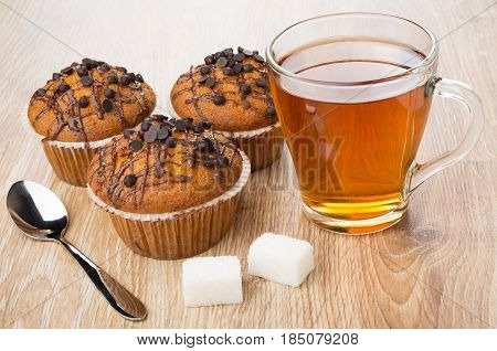 Muffins, Transparent Cup Of Tea, Lumpy Sugar And Spoon