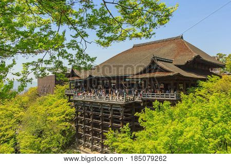 KYOTO, JAPAN - APRIL 18, 2015: Tourists visit Kiyomizu-dera temple. The temple is part of the Historic Monuments of Ancient Kyoto UNESCO World Heritage site.