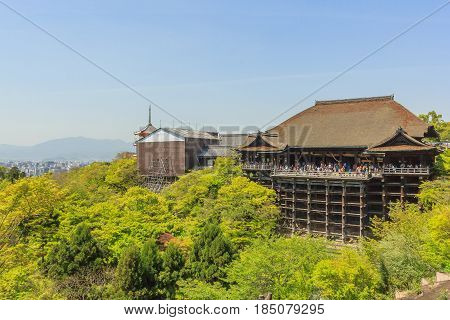 KYOTO, JAPAN - APRIL 18,2015: Tourists visit Kiyomizu-dera temple. The temple is part of the Historic Monuments of Ancient Kyoto UNESCO World Heritage site.