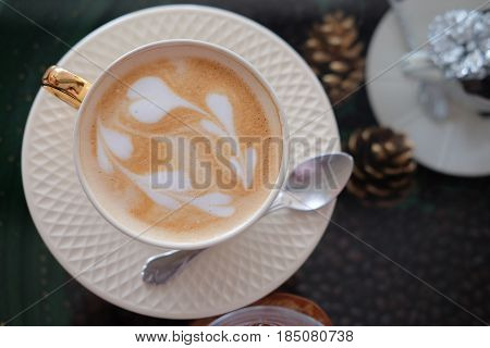 Hot coffee with foam milk art of love Cup of coffee