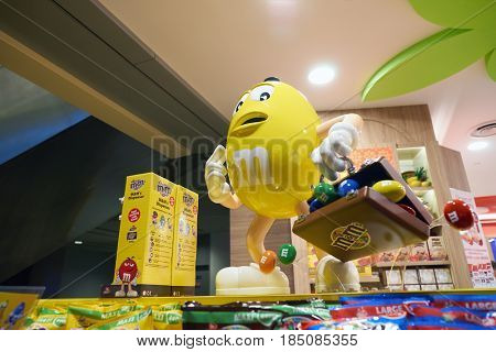 SINGAPORE - CIRCA AUGUST, 2016: M&M candy yellow character on display at store in Singapore Changi Airport. Changi Airport is one of the largest transportation hubs in Southeast Asia.