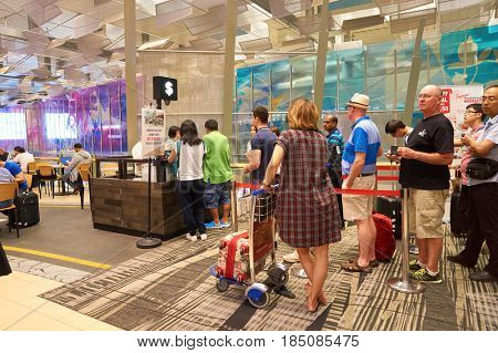 SINGAPORE - CIRCA AUGUST, 2016: people queue at Singapore Changi Airport. Changi Airport is one of the largest transportation hubs in Southeast Asia.