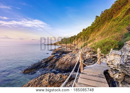 wooden walkway bridge seashore with mountain landscape in morning sunrise at Khao Laem Ya National Park Rayong Province Eastern Thailand